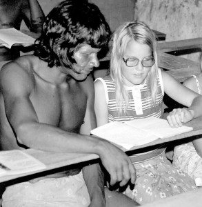 Eight year-old Cheryl coaching a Canela adult through the learn-to-read booklet.