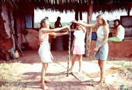 Village house chores, sweep dirt floor, whack snake with broom.